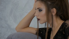 Beautiful young sexy woman in black lingerie on a photo shoot. Close-up Stock Footage