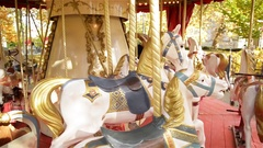 View on a Carousel in the Park Attraction. Vintage Merry-go-round Horses Stock Footage