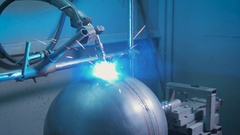 Arc welder at work on the production. From electric discharge sparks appear and Stock Footage