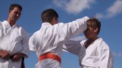 Children Fighting At Karate School With Teacher Slow Motion Arkistovideo