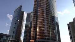 Curved glass facade of modern office skyscraper, low angle shot Stock Footage