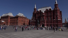 People go at Manezhnaya square, Russian Baroque building of Historical Museum Stock Footage