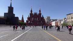 Sightseers and citizens on Red Square, POV camera walk towards Historical Museum Stock Footage