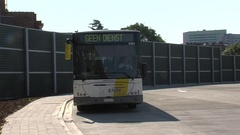Public Transport Bus riding away from terminal Stock Footage