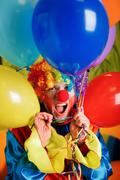 Clown with a bunch of colorful air balloons. Kuvituskuvat