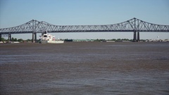 Cargo Ship Leaving Port of New Orleans on the Mississippi River Stock Footage