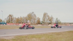 Go-kart track. People racing in karts accidentally hit Stock Footage