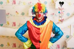 Serious clown in funny costume. Kuvituskuvat