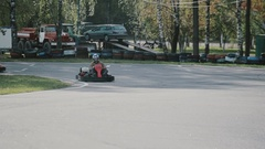 Go-kart track. People racing in karts. Sunny autumn day Stock Footage