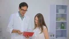 Doctor patient discuss matters on a tablet Stock Footage