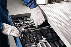 Auto mechanic with working tools For repair and diagnostics of cars in the Stock Photos