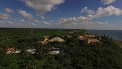 Aerial of homes on the dominican republic ocean shore line Stock Footage