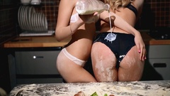 Two nude girls pouring milk on each other booty Stock Footage