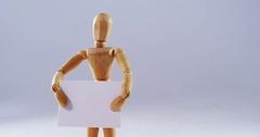 Figurine holding blank placard Stock Footage