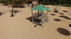 Aerial of lifeguard tower on carribean beach Stock Footage
