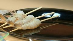 4k video. Girl skewer raw prawns on skewers Stock Footage