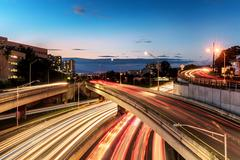 Light trails on busy city highway Stock Photos