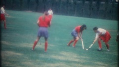 Player is down as college girls play field hockey, 3816 vintage film home movie Stock Footage
