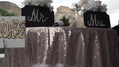 Slow motion footage of a wedding reception table for bride & groom Stock Footage