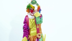 Funny young female clown dancing comically thinking she is pretty Stock Footage