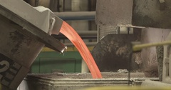 Liquid aluminum is poured from a huge vat Stock Footage