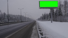 Billboard green screen chromakey near the winter highway Stock Footage