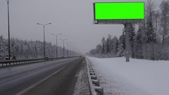 Billboard green screen chromakey near the winter highway Stock Footage
