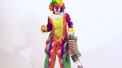 Circus clown dressed in funny colorful costume is enjoying her dance Stock Footage