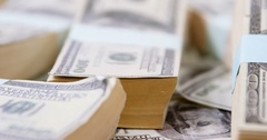 Bundles of hundred dollar currency notes Stock Footage