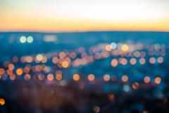 City blurring lights abstract circular bokeh on blue background with horizo.. Kuvituskuvat