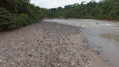 Flying low over a gravel beach beside Rio Misahualli in the Ecuadorian Amazon Stock Footage