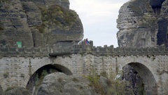 Tourist couple watch from Bastei bridge rock formations viewpoint, Germany Stock Footage