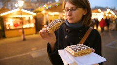 Woman eating traditional waffles Stock Footage