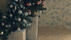 Little cute girl hides behind Christmas tree and then run away Stock Footage