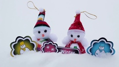 Snowmen with pictures under snow Stock Footage