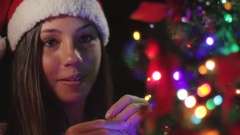 Close Up Of A Beautiful Girl Arranging Christmas Tree And Dropping Ball Ornament Stock Footage