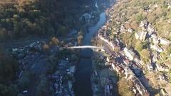 Tilting aerial reveal of Iron Bridge, Shropshire, UK. Stock Footage