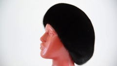Black beret from natural mink on mannequin Stock Footage