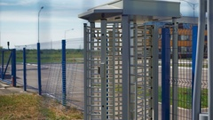 Large turnstile at the entrance to the territory. Protection against intrusion Stock Footage