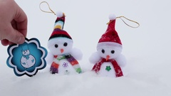 Winter snowmen with pictures under snow Stock Footage