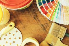 Various painting tools and color guide on wooden background Stock Photos