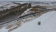 Railroad delivery. Freight train with cargo vagons and tanks passing by. Aerial Stock Footage