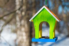 Horizontal picture bird feeders handcrafted in the forest Stock Photos