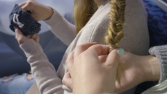 Closeup Of Young Woman Braiding Her Friend's Hair On Train Stock Footage