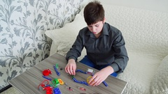 Boy studying operation of fan on electrical circuit in constructor Stock Footage