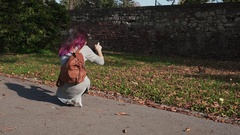 Young woman photographing little squirrel in park Stock Footage