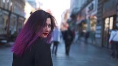 Purple haired woman having fun in the street Stock Footage