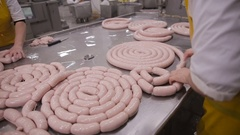 Production of sausages. Worker operates meat processing equipment at a meat Stock Footage
