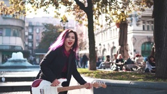 Fashionable beautiful girl with electric guitar Stock Footage