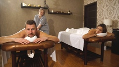 A woman and a man during a couples massage Stock Footage